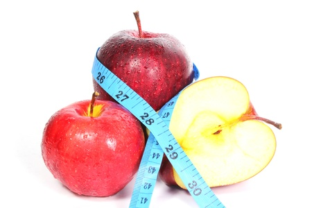 measurement tape: Three Red apple and measurement tape