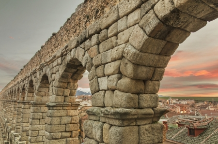 Segovia Aqueduct at dusk  Famous Spanish Landmark Stock Photo