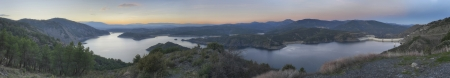 Panoramic landscape of El Atazar Dam at sunset in Madrid, Spain  photo