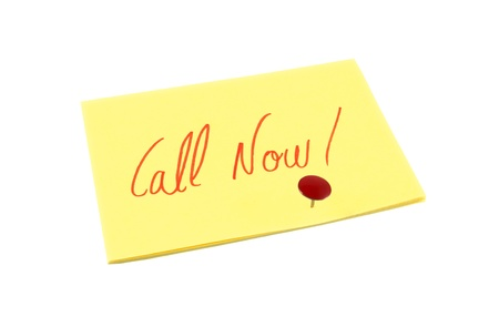 Call Now  reminder note over white isolated background photo