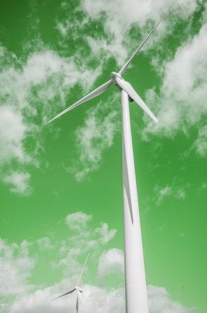 wind energy turbines over green cloudy sky. Green energy concept photo