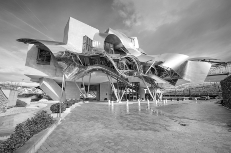 frank gehry: ELCIEGO, SPAIN - JANUARY 6: Winery of Marques de Riscal on January 6, 2014 in Elciego, Basque Country, Spain. This modern winery was designed by world famous architect Frank Gehry.
