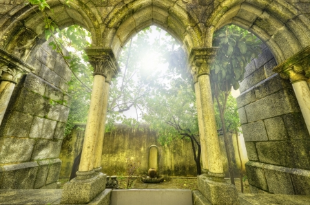 myst: Ancient gothic arches in the myst. Fantasy landscape in Evora, Portugal.