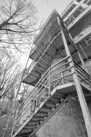 Detail of creepy stairs in an abandoned building in black and white photo