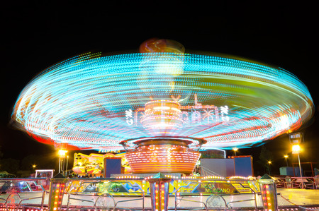 COLLADO VILLABA, SPAIN - JULY, 27: Long eposure picture of a carrusel rotating during the local fair in a small amusement park in Collado Villaba, Spain, on July 27, 2014.