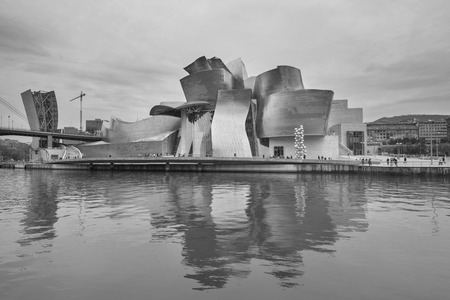 bilbo: Bilbao, Spain - October 16, 2016: view of modern and contemporary art Guggenheim Museum in black and white, designed by architect Frank Gehry and inaugurated in October 1997.