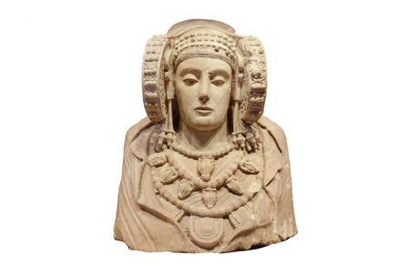 MADRID, SPAIN - CIRCA 2014: Lady of Elche on white isolated background. Is the most important  piece of Iberian art. Produced in the fourth century B.C. Was discovered in 1897 at LAlcúdia, an archaeological site