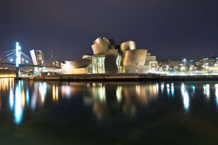 bilbo: Bilbao, Spain - October 16, 2016: night view of modern and contemporary art Guggenheim Museum, designed by architect Frank Gehry and inaugurated in October 1997. Editorial