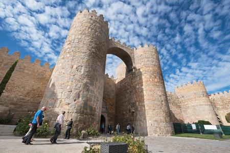 Avila, Spain - October 27: Tourist visiting famous walls on October 27, 2016 in the medieval city of Avila, Spain.