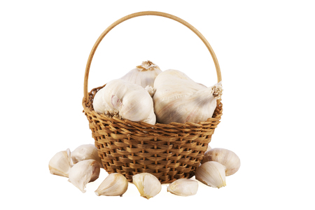 Garlics in a basket over white isolated background