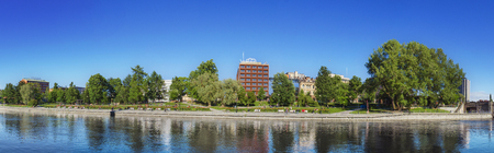 backwater: TAMPERE, FINLAND - JUNE 2012: Panorama of Tampere river with hotels and office buildings in the background on June 16, 2012 in Tampere, Finland.