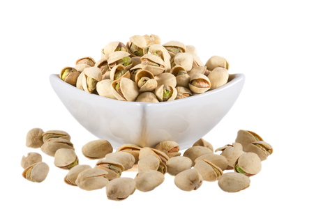 nutshells: Pistachios isolated on white background