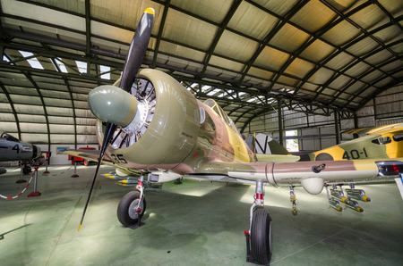 cuatro: Madrid, Spain - September 5, 2015: Interior of an hangar with some rare vintage interceptor airplanes on September 5,2015 in Madrid air museum, Spain.