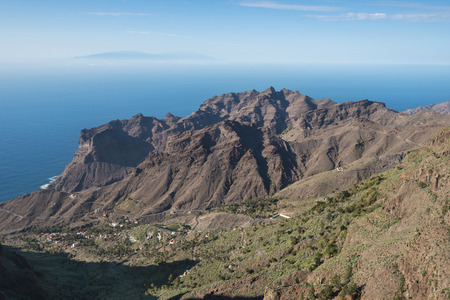 La Gomera landscape, breath taking Canyons and cliffs with La Palma island in the background, Canary islands, Spain.  Stock Photo