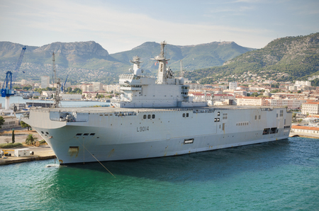 toulon: Toulon, France - August 16, 2013: Toulon Navy base harbor, Aircraft carrier ship docked on August 16, 2013 in Toulon, France.