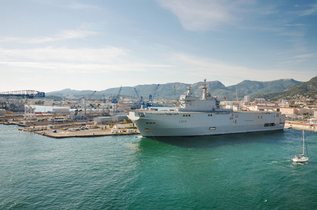 Toulon, France - August 16, 2013: Toulon Navy base harbor, Aircraft carrier ship docked on August 16, 2013 in Toulon, France.