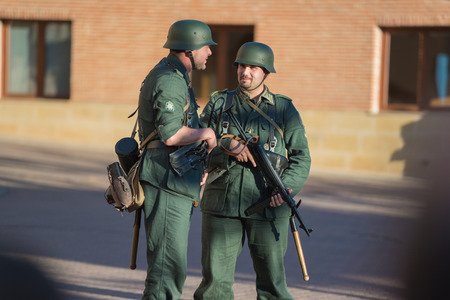 Belorado, Spain - May 6, 2017: German soldiers in World war 2 reenactment,  Military historical reconstruction of the battle of Salerno 1943, on May 6, 2017 during Expohistorica festival in Belorado, Burgos, Spain.