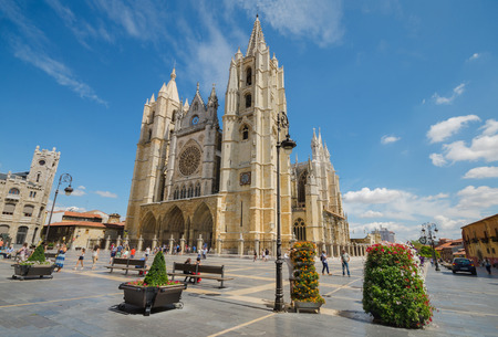 Leon, Spain - August 22, 2014: Tourist visiting famous landmark Leon city cathedral on August 22, 2014 in Leon, Spain.