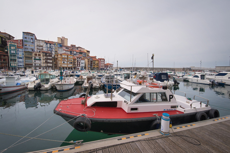 Bermeo, Spain - May 28, 2017: Port of Bermeo on a cloudy day. Bermeo is a small fishing town in cantabric sea coast, basque country, Spain.