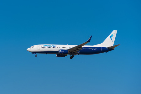 rumanian: Madrid, Spain - May 22, 2017: Blue Air Boeing 737 85R is landing in Madrid Barajas airport on May 22, 2017. Blue Air is a low cost Rumanian airways company. Editorial