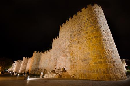 Night scene of famous Avila city walls in Castilla y Leon, Spain.