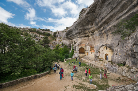 Ojo Guarena, Spain - August 15, 2015: Tourist visiting ancient cave heremitage of St Bernabe, in Burgos, Spain. 에디토리얼