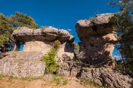 La Ciudad encantada. The enchanted city natural park, group of crapicious forms limestone rocks in Cuenca, Spain. 스톡 콘텐츠 - 104539362