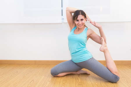 Young attractive woman practicing yoga Stockfoto