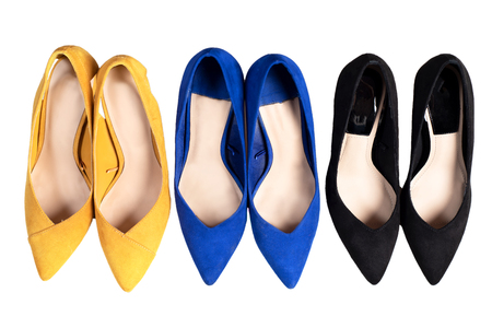Fashionable Shoes on high Heels. Woman Shoes Isolated on the White Background, top view.