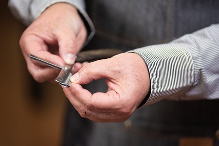 Close up of barber hands changing the razor. Barber hairstyle series.