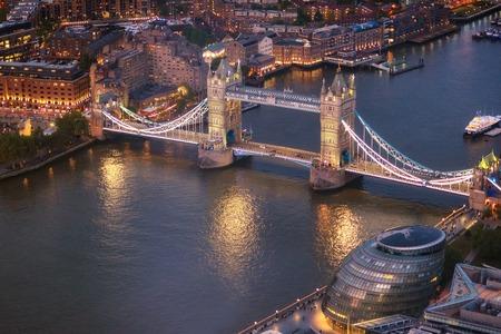 Tower Bridge and River Thames aerial view at magic hour, London, United Kingdom.