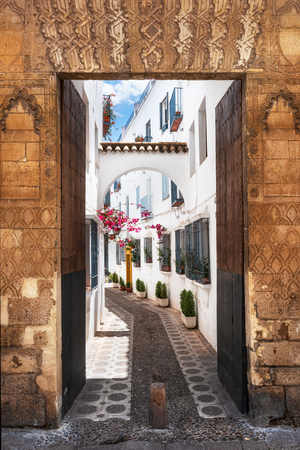 Ancient gate and street in Cordoba, Spain.