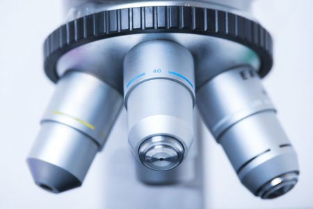 Microscope close-up photo. Microscope with multiple eyepieces. Stock Photo