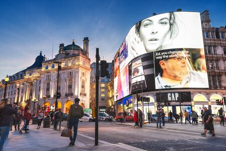 London, United Kingdom - May 13, 2019: Famous Piccadilly Circus square. Neon signage shines at night. These signs have become a major attraction of London.