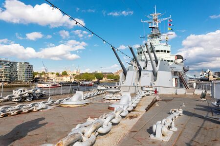 London, United Kingdom - May 13, 2019: View of HMS Belfast Royal Navy light cruise - warship Museum in London. Belfast moored in London on River Thames and operated by the Imperial War Museum. 에디토리얼