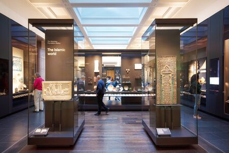 London, United Kingdom - May 13, 2019: The British Museum, London. Islamic art exhibition, archeological artifacts, visitors and tourists admiring the exhibition. 스톡 콘텐츠 - 132988388