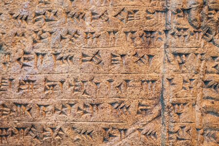 Ancient Assyrian and Sumerian cuneiform writing carving on stone from Mesopotamia.