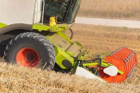 Combine harvester close up. Combine harvester harvesting wheat at sunset. 写真素材 - 128872168