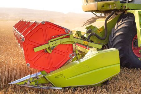Combine harvester close up. Combine harvester harvesting wheat at sunset. 写真素材 - 128872188