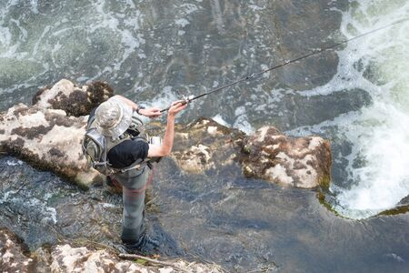 Aerial view of sport Fisher fishing in the river.