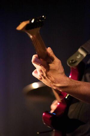 Guitarist hands playing electric guitar. Close up .
