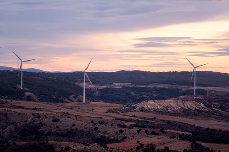 Windmill for electric power production. Landscape with Turbine Green Energy Electricity.