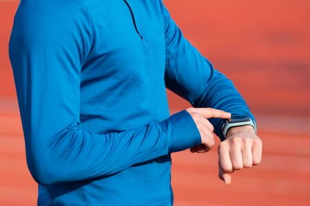 Successfully Runner Looking At Heart Rate Monitor Smart Watch, close up. Фото со стока