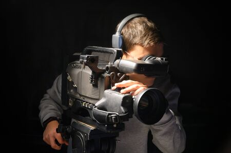 Cameraman using professional digital video camera.