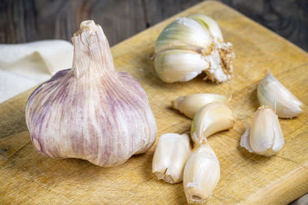 Still life with garlics on rustic wood table. Stock Photo
