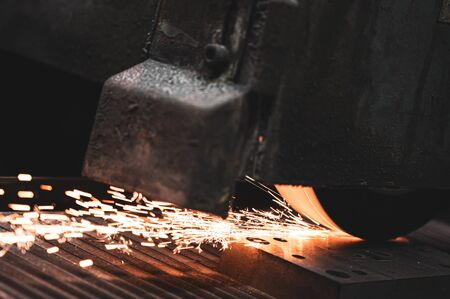 Industrial Processing of metal, grinder with sparks .