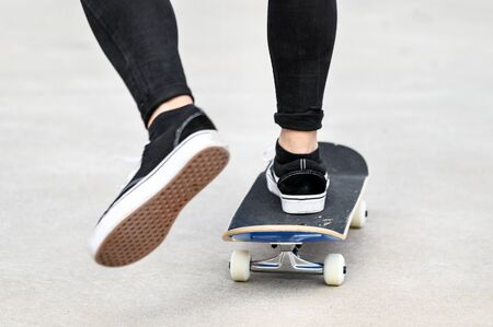 Close up of young man riding a skateboard at the skate park.