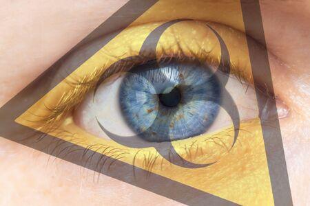 Coronavirus global Pandemic outbreak and quarantine concept. Creative composite of of woman eye with biohazard symbol. Archivio Fotografico