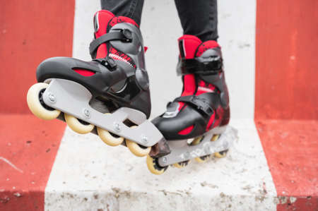 Close-up Of Legs Wearing Roller Skating Shoe, Outdoors urban lifestyle portrait. Stock Photo - 150818296