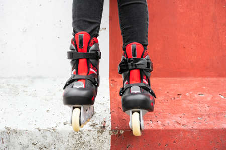 Close-up Of Legs Wearing Roller Skating Shoe, Outdoors urban lifestyle portrait. Stock Photo